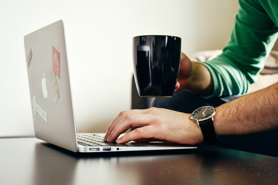male on laptop taking surveys for money